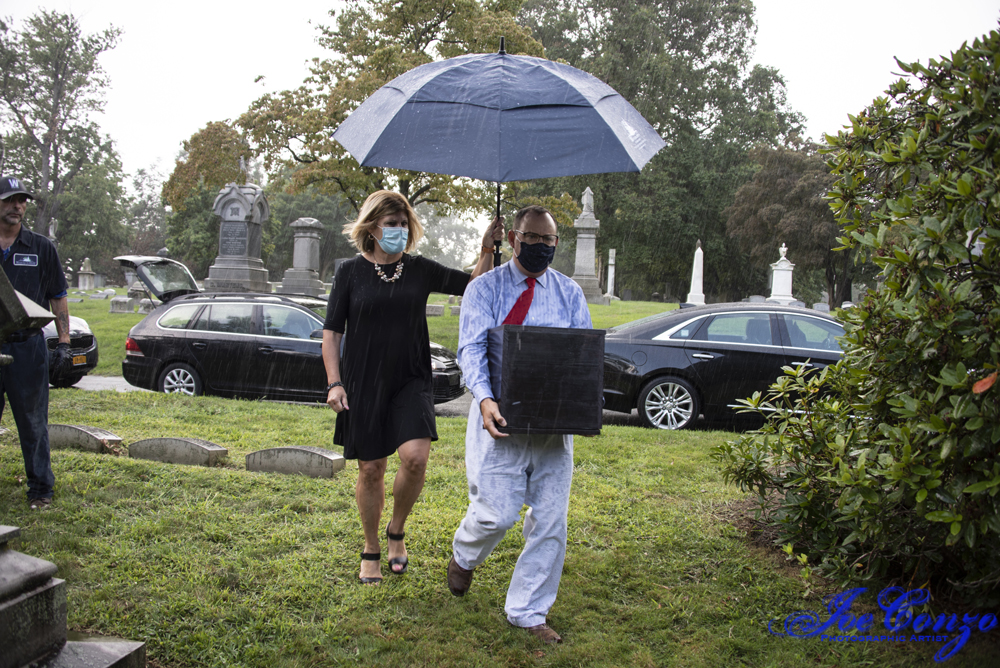 Kevin C. Fitzpatrick brings box with urn to family plot at Woodlawn with Barbary Selesky, marketing director.