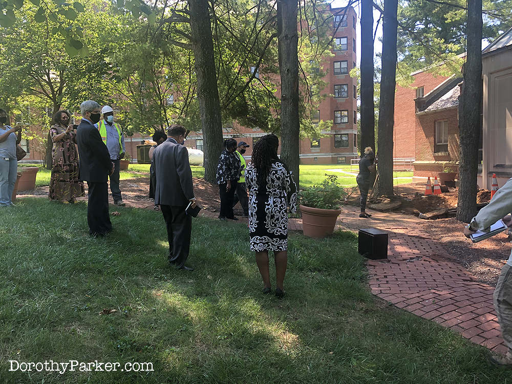 NAACP conducts socially distance ceremony after urn removed from ground.
